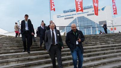 Event director Charlie Cracknell shows guests around ExCeL.
