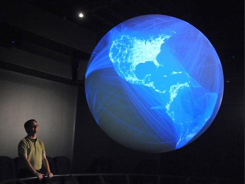 Facebook friends on 3-D sphere  NOAA's three-dimensional Science on a Sphere also can be used to show any of more than 400 datasets, such as this one showing a plot of 10 million pairs of Facebook Friends.  Image credit: NOAA, Museum of Natural History Halifax.