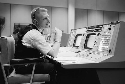 NASA flight director Eugene F. Kranz, at his console on May 30, 1965, in Houston. (NASA Photo)