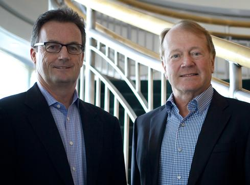 Cisco president Rob Lloyd, left, and CEO John Chambers, right