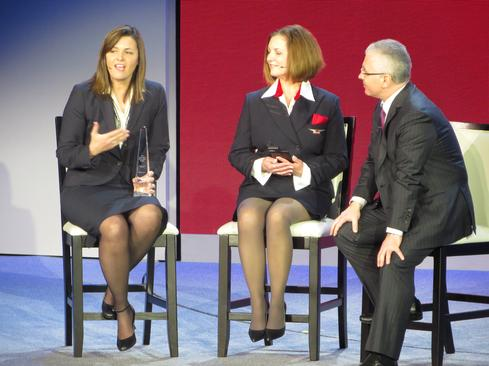 Delta Airlines senior VP and CIO Theresa Wise, left, discusses mobile capabilities will a flight attendant colleague and Microsoft Business Solutions executive VP Kirill Tatarinov.