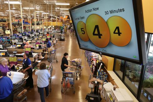 Kroger's QueVision system includes a display that keeps customers and store staff informed about how checkout lines are moving.