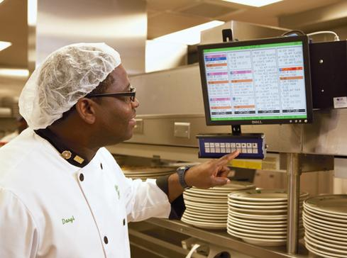 The Kitchen Display System developed by Darden tells cooks what to prepare and when, to pace the delivery of appetizers, entrees, and desserts.
