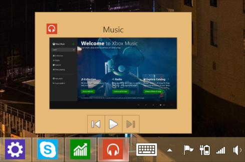 Open Windows Store apps are viewable on the taskbar as thumbnails, some of which, such as the Xbox Music App, include basic controls.
