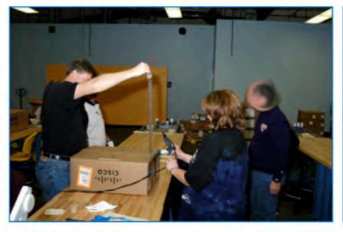 Photo from Glenn Greenwald's book that allegedly shows NSA representatives intercepting and altering Cisco equipment on its way to customers.