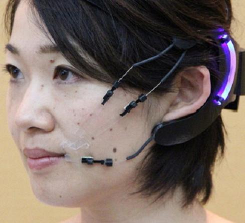 Wearable mask helps move voluntary muscles that have degraded due to medical ailments. 