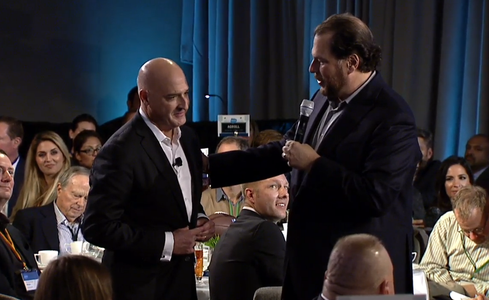 Salesforce CEO Mark Benioff congratulates president and vice chairman Keith Block, who has just been promoted to chief operating officer, as well.