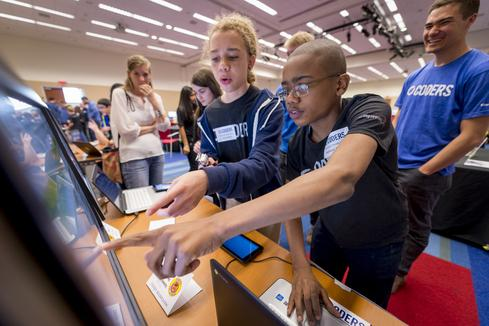 To help close the gender gap in Science, Technology, Engineering, and Mathematics (STEM) education, Capital One -- the No. 1 company in the 2016 Elite 100 -- created C1 Coders, a special 10-week coding curriculum for middle school students led by Capital One volunteers. (Image: Capital One)