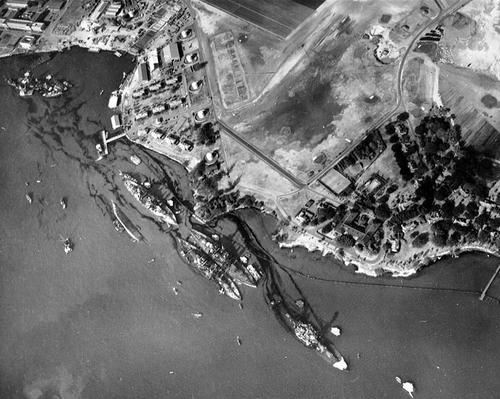 An aerial view of 'Battleship Row' moorings at Pearl Harbor, which shows damage from the Japanese raid conducted three days earlier. (Source: Wikipedia)