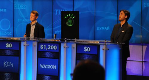 Ken Jennings (L), IBM Watson, and Brad Rutter (R) compete on Jeopardy!