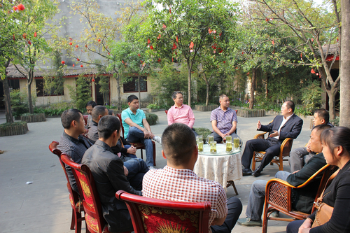 MicroCred Sichuan held a joint 'Client Thanks Meeting' in 2013 in a local rural restaurant. (Source: MicroCred)