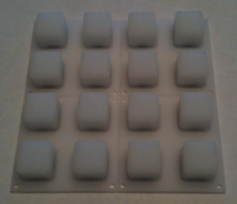 Top-side view of the translucent silicon rubber button pad.