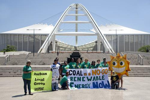 Durban Environmental Protection Forum & Cooperative standing in front of Moses Mabhida Stadium  (Source: Teagan Cunniffe | world.350.org/africa/)