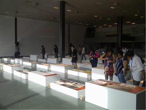 Delegates browsing the exhibition space in Fira Barcelona at the World Bank's Urban Research and Knowledge Symposium 'Rethinking Cities.'