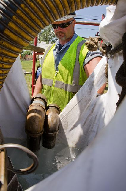 A technician helps replace a sewer pipe lining in Buena Vista Township, Mich.  (Source: USDAgov)