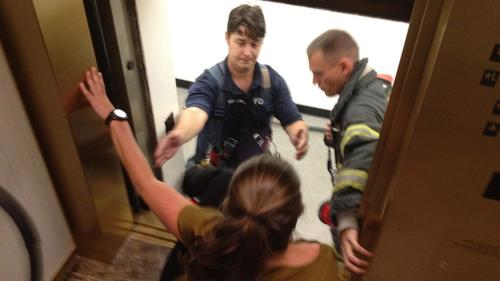 Nicole's UBM colleague Julie Muroff being rescued from stalled elevator last September. (Photo credit: Steve Saunders)