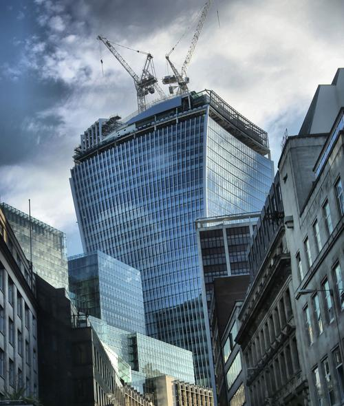 The Walkie-Talkie skyscraper looming over other buildings in the City of London.