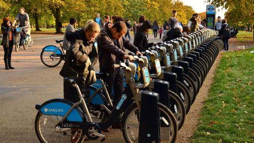 People hiring bikes from London's bike share scheme.
