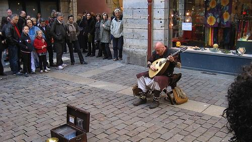 Example of a 'busker,' or a street performer, in Lyon, France. (Source: Danny Howard via Flickr.)