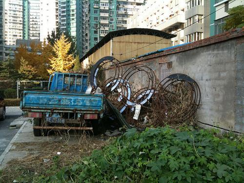 Olympic rings in ruins in Beijing. (Photo: Edward Sanderson via Flickr)