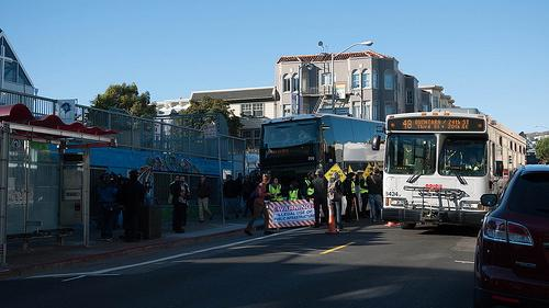 Protesters confronting a Google bus.