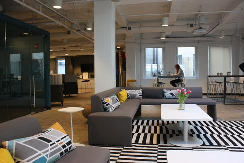 As it is at many co-working offices, communal workspace is a central feature of this facility. Workers can gather informally to share ideas or have quick meetings.
