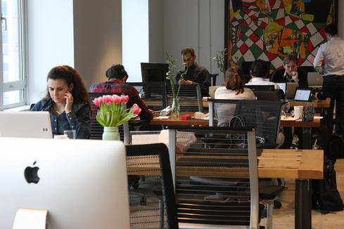 Workers in this part of the space require little more than a table, a chair, and WiFi. There are small offices available, but those are booked under longer-term leases in the space.