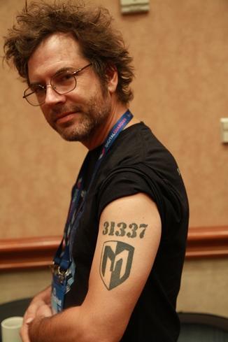 Metasploit Framework manager Tod Beardsley of Rapid7 rocks his literally 'leet' tattoo at Black Hat USA.