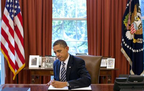 President Obama signing legislation. (White House Photo by Pete Souza taken in 2011.)