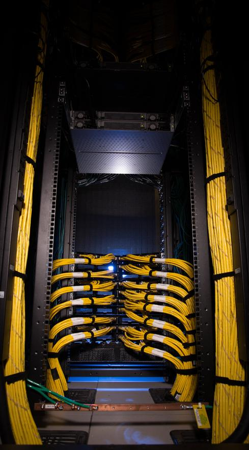 GM puts computing near power users The people who soak up the most computing power at General Motors are engineers doing CAD drawings of new vehicles and those simulating crashes. It's no coincidence that the automaker built its two new data centers alongside two existing GM locations in Michigan where most of those teams work.  Limiting the distance all that data must travel saves on networking costs and improves responsiveness, notes Jeff Liedel, who leads the data centers as executive director of global IT operations. GM modeled its two new data centers on the cutting-edge practices of Web giants such as Facebook and Google -- for example, it uses in-row cooling and x86 commodity servers. But it also needed to accommodate legacy apps not built for a Web architecture.  Name-brand, highly virtualized x86 servers provide most of the automaker's computer power, running a standard software stack that includes Linux OS, VMware, Oracle database, and WebLogic Java application server. But this isn't a private cloud for purists. It isn't one single, general-purpose pool of compute, storage, and networking, because many of GM's applications run best on dedicated hardware. 'Like any other 50- or 100-year-old company, we have a lot of other stuff,' Liedel says. That other stuff includes Solaris servers, as well as mainframes that run 300 different applications, including systems that process tens of billions of dollars in material and parts purchases. GM's Outlook and Exchange apps run on Windows servers.  Liedel distinguishes between 'cloud-ready apps' that can run on the shared private cloud part of GM's environment and older apps that don't fit that model. CAD/CAM probably will never be a cloud app, he says, because it requires so much graphics-intensive local computing. But other apps, such as expense reporting, run on a private cloud environment.  GM's $130 million Warren, Mich., data center opened last summer, and its Milford, Mich., center is due to open this summer. G