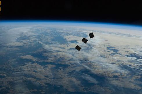 Several tiny satellites, photographed from the International Space Station. (Image: NASA)