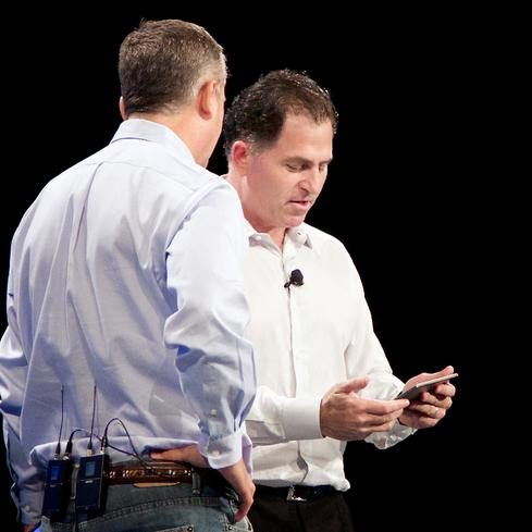 Dell CEO Michael Dell (right) and Intel CEO Brian Krzanich check out Dell's Venue 8 7000 tablet.