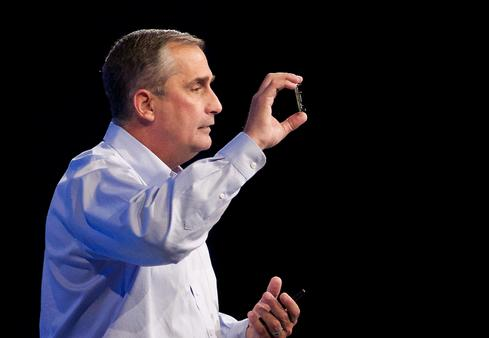 Intel CEO Brian Krzanich holds up his company's IoT-oriented Edison SoC.