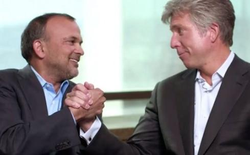 Concur Technologies CEO Steve Singh, left, shakes hands with 