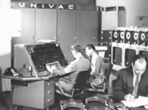 UNIVACThis UNIVAC TV commercial, which aired on CBS in February 1956, is one of the first on-camera appearances of IT professionals. Among the first computers sold commercially, the UNIVAC was manufactured by Remington Rand and later the Univac division of Sperry Rand. Notice the three no-nonsense, heads-down programmers, working with paper printouts. Like every other male office worker in the 1950s, thin ties and jackets were the mandatory uniform. Also notice the cool animation in this early ad: