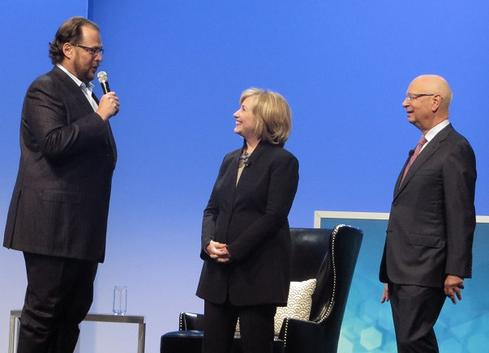 Salesforce.com CEO Marc Benioff, former Secretary of State Hillary Clinton, and World Economic Forum founder Klaus Schwab.