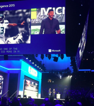 Russell Wilson joins Nadella onstage.