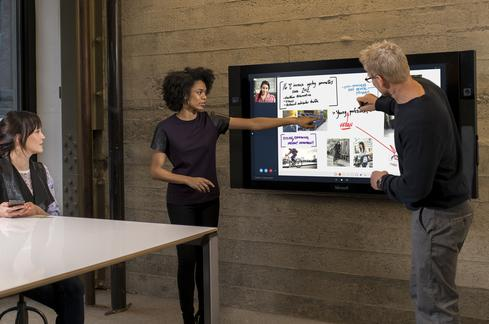 Multiple cameras on the Surface Pro allow remote participants to see both people at the conference table and those writing on the board.(Image: courtesy of Microsoft)