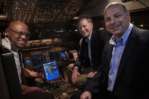Barnes and Costides, with Airlines Capt. Norman Seawright. UPS runs the world's ninth largest airline as part of its worldwide delivery network.  (Image: UPS)