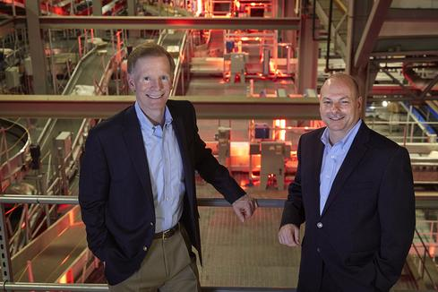 CIO Dave Barnes and Group VP Nick Costides, in UPS's Worldport, the world's largest automated package handling facility. 