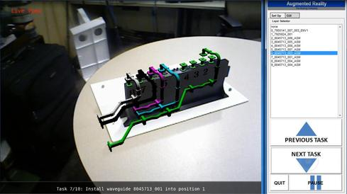An augmented reality view, with digital designs on a real component