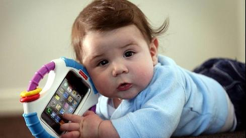 At Least 1 Hour Per Day That's how often 14% of respondents said their one-year-olds were using a smartphone. Presumably they're texting with friends while hanging in the crib.  (Image: Country104.3com)