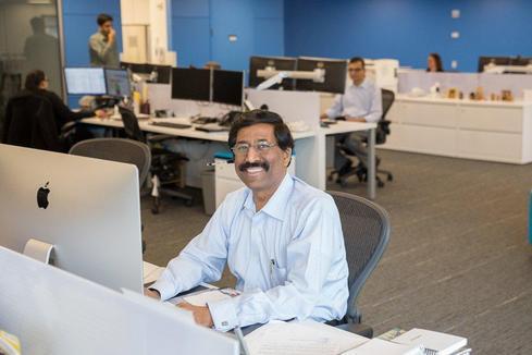 CIO Suresh Kumar at his desk at the Jersey City Innovation Center (Image: Bank of NY Mellon)
