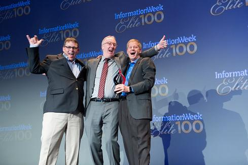 InformationWeek Conference chairman Brian Gillooly, center, with executives from The Weather Company onstage at the Elite 100 2015 awards ceremony.