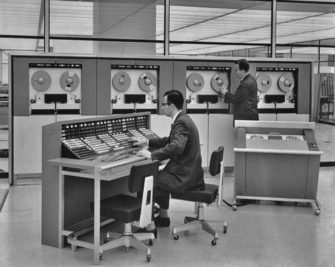 Operating a mainframe, circa 1960.