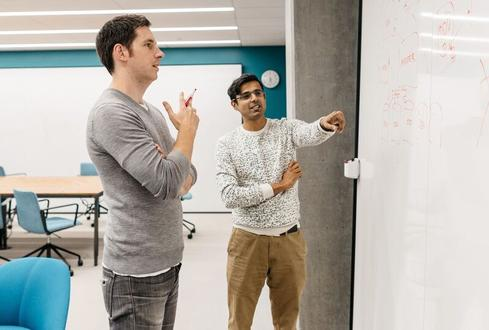 Akhil Gupta (right) and James Cowling, together, at their Dropbox offices. (Image: Dropbox)