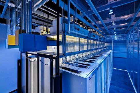 The Aligned Energy data center in Plano, Texas, with thermal bus cooling units above server racks