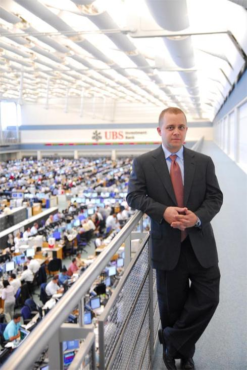 Will Sterling, Head of Global Direct Execution, UBS, stands on the catwalk looking down on the largest trading floor in the world.